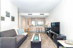 A seating area at DD Apartments on Day