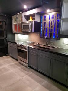 A kitchen or kitchenette at The 3060 Guest House
