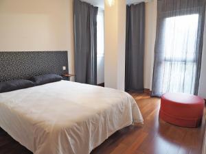 Cama o camas de una habitación en APARTAMENTO BOLTAÑA