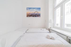 Ein Bett oder Betten in einem Zimmer der Unterkunft Herzlich Willkommen - Küss die Hand 2