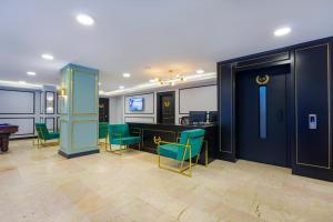 Лобби или стойка регистрации в King's Suit Apart Otel