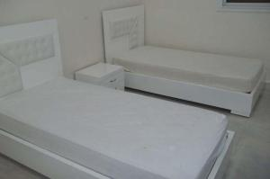A bed or beds in a room at Village du golf Midoun