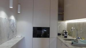 A kitchen or kitchenette at The Porto way