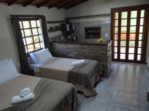 Cama ou camas em um quarto em Recanto 438