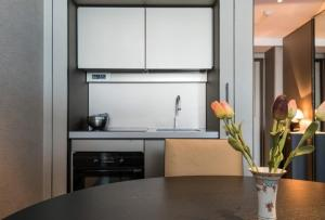 A kitchen or kitchenette at Sea view downtown Apartment