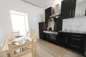 A kitchen or kitchenette at Vienna Living Apartments - Dammstraße