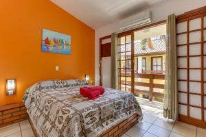 Cama o camas de una habitación en Lemuria Apart Hotel