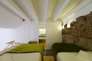 Uma cama ou camas num quarto em Guimarães Studios Lounge