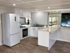 A kitchen or kitchenette at Absolute Beachfront Holiday Shack