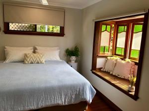 A bed or beds in a room at Absolute Beachfront Holiday Shack