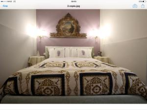 A bed or beds in a room at Appartamento Luxury Ai Greci