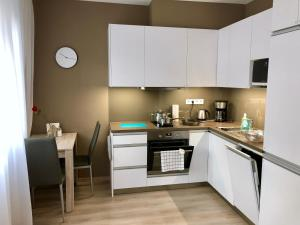 A kitchen or kitchenette at Cool Bratislava Apartment - A/C - Private Parking - Wifi