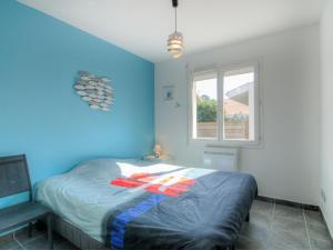 A bed or beds in a room at Holiday Home La Plage
