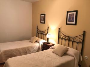 A bed or beds in a room at CASA RURAL LA IBIENZA