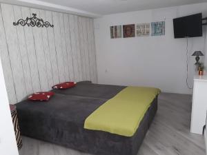 Łóżko lub łóżka w pokoju w obiekcie Willa Joanna