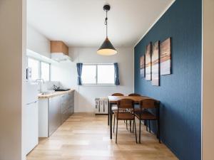 A kitchen or kitchenette at Ikidane House Onnason Maeda