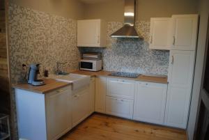 A kitchen or kitchenette at Gite chez Phil