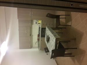 A kitchen or kitchenette at Appartamento Valle dei Templi