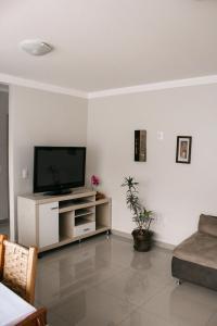 A television and/or entertainment center at Apartamento do Luiz