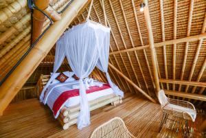 A bed or beds in a room at Wirguna Bamboo Ubud