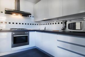 A kitchen or kitchenette at Dateo Halldis Apartments