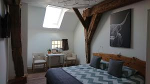 A bed or beds in a room at Bed & Breakfast In den Groene Specht