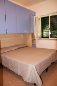 Кровать или кровати в номере Baia di Zambrone