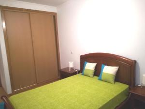 A bed or beds in a room at Apartamento Horizonte