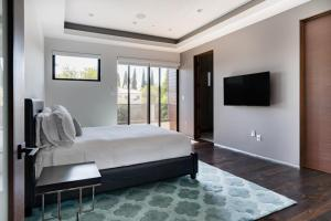A bed or beds in a room at Villa Woody
