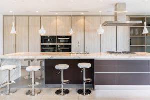 A kitchen or kitchenette at Villa Woody