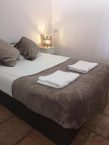 A bed or beds in a room at The Haven