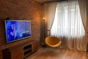 Телевизор и/или развлекательный центр в Loft Apartment