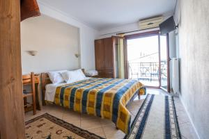 A bed or beds in a room at Holiday Zigos