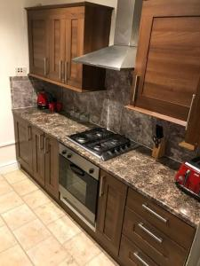 A kitchen or kitchenette at Greystoke Court