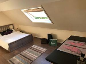 A bed or beds in a room at Greystoke Court