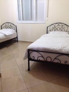 A bed or beds in a room at Oued Laou واد لاو