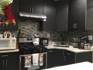 A kitchen or kitchenette at Check In New York