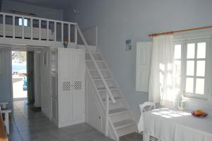 A bed or beds in a room at Atlantida Villas