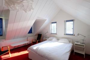 A bed or beds in a room at Bie de Borreger