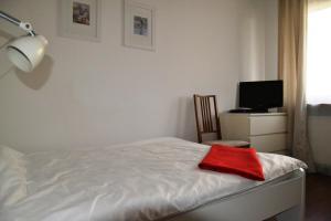 Een bed of bedden in een kamer bij Great Apart Kabaty