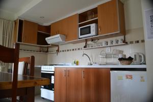 A kitchen or kitchenette at Selknam