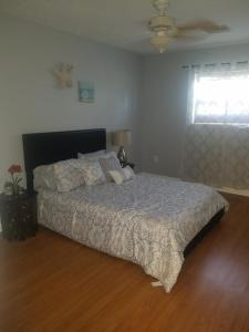 A bed or beds in a room at 12316 Eldon Dr Vacation Home