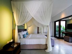 A bed or beds in a room at The Amala