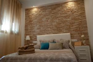 Cama o camas de una habitación en Apartamentos Cantarería, Jazmín.