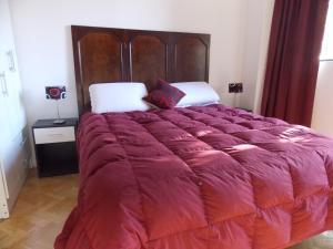 Una cama o camas en una habitación de Bosques & Lagos Palermo