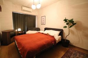 A bed or beds in a room at 京都寿~KYOTO KOTOBUKI~