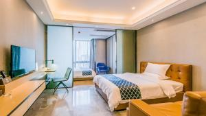 A room at Nuomo Beijing Rd. A Jiedeng Mix International Apartment
