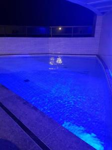 The swimming pool at or close to Apartamento em Boa Viagem