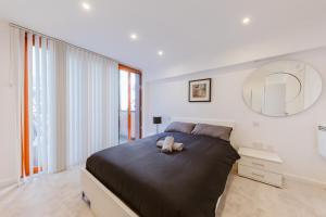 Ein Bett oder Betten in einem Zimmer der Unterkunft Rosea apartment