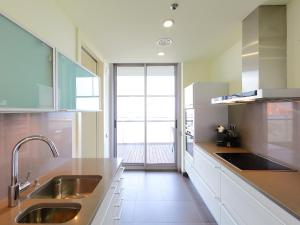 A kitchen or kitchenette at Apartment Diagonal Mar